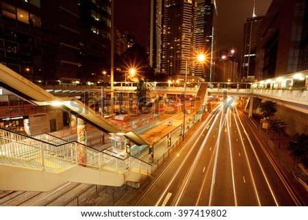 HONG KONG, CHINA - FEB 10: Dark streets with hotels, skyscrapers and motion lines near city tram stop on February 10, 2016. Hong Kong dollar is the eighth most traded currency in the world. - stock photo
