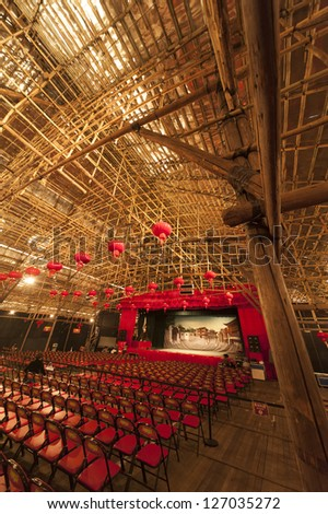 HONG KONG , CHINA - FEB. 04 : West Kowloon Bamboo Theatre on Feb 04 , 2013 in Hong Kong. This temporary theatre is made of bamboo and for traditional Chinese opera during the Chinese New Year. - stock photo