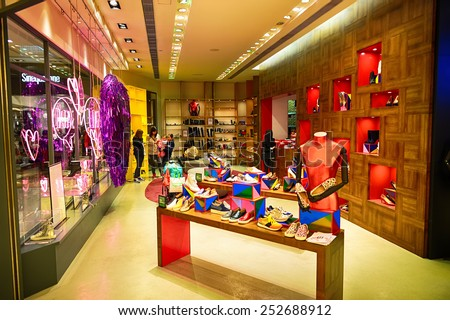 HONG KONG, CHINA - FEBRUARY 04, 2015: shopping center interior. In Hong Kong a wide selection of clothing boutiques, designer flagship stores, restaurants, daily shows and exhibitions - stock photo