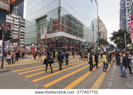 Hong Kong - China, 14 January, 2016: Tourists walking in Nathan Road close to Victoria Harbour