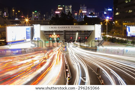 Hong Kong, China - June 19, 2015: Busy traffic of the Cross Harbour Tunnel in Hong Kong. It is one of the most congested roads in Hong Kong. - stock photo