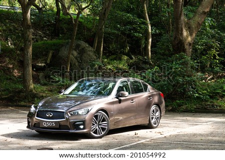 Hong Kong, China June 19, 2014 : Infiniti Q50S hybrid sedan test drive on June 19 2014 in Hong Kong. - stock photo