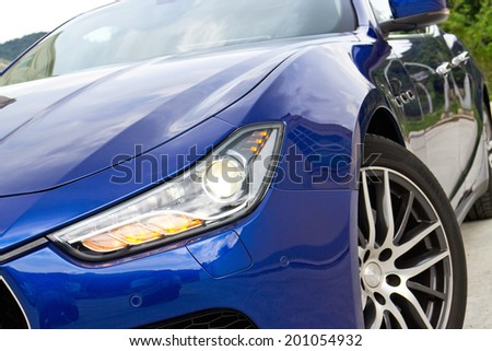 Hong Kong, China June 5, 2014 : Maserati Ghibli sport sedan head light on June 5 2014 in Hong Kong. - stock photo