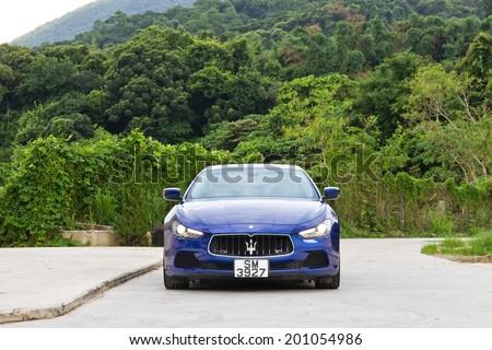 Hong Kong, China June 5, 2014 : Maserati Ghibli sport sedan test drive on June 5 2014 in Hong Kong. - stock photo