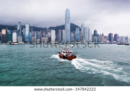 HONG KONG, CHINA, JUNE 24: View to Victoria Harbor and a heavy dark monsoon clouds over the business center with skyscrapers,  Hong Kong island on June 24th 2013.  - stock photo
