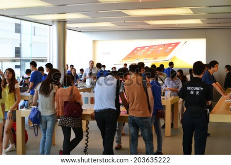 HONG KONG/CHINA - MAY 25: Apple shop and showroom in IFC Mall on May 25th 2014. Apple is one of the most visited shops in the IFC shopping center and in Hong Kong. - stock photo