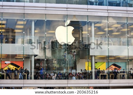 HONG KONG/CHINA - MAY 25: External view of Apple shop and showroom in IFC Mall on May 25th 2014. Apple is one of the most visited shops in the IFC shopping center and in Hong Kong. - stock photo