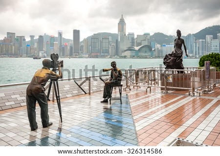 Hong Kong, China - October 05, 2015 : Statue and skyline in Avenue of Stars in Hong Kong, China. The promenade honours celebrities of the Hong Kong film industry as the famous attraction. - stock photo