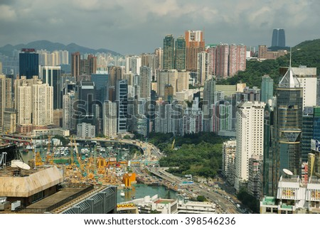 HONG KONG, CHINA - SEPTEMBER 23, 2015: Skyline of the skyscrapers from Central Plaza building in Hong kong island. - stock photo