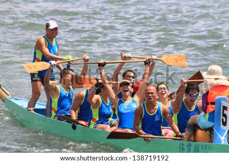 HONG KONG, CHINA - SEPTEMBER 2: Unidentified team competes at the 2012 Dragon Boat Race in Sai Kung bay on September 2, 2012 in Hong Kong, China.