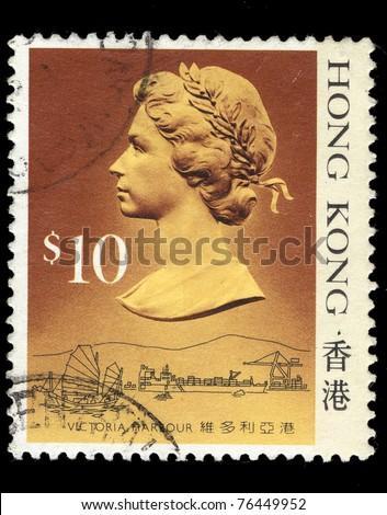 HONG KONG - CIRCA 1987: A stamp printed in Hong Kong shows Queen Elizabeth II, Victoria Harbour, circa 1987 - stock photo