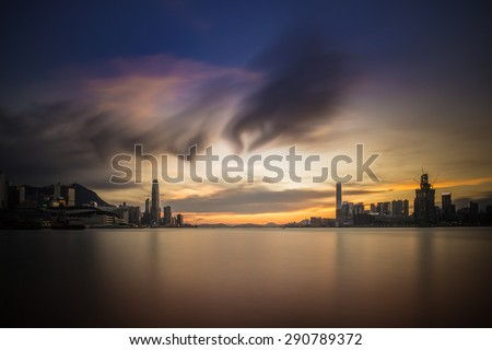Hong Kong city captured under sunset with HDR tone tuned - stock photo