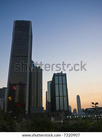 Hong Kong City Office Buildings in Wan Chai at sunset as night falls. - stock photo