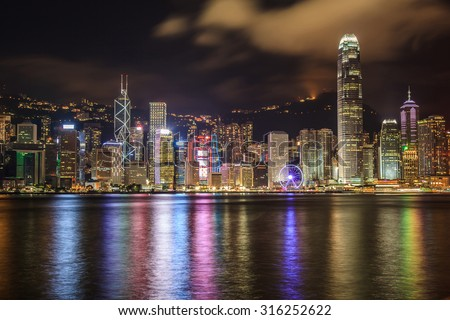 Hong Kong city skyline at night over Victoria Harbor - stock photo