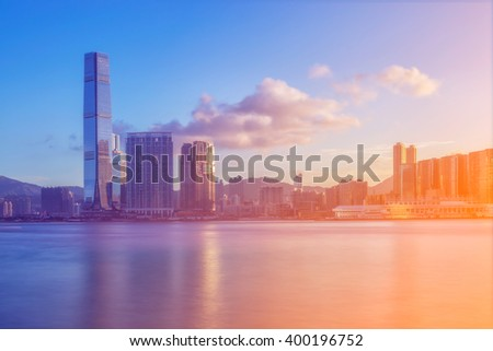 Hong kong city with river and sunrise.
