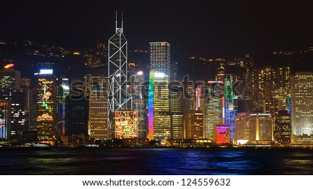 HONG KONG - DECEMBER 12: Cityscape of Hong Kong Island across Victoria Harbor at night on December 12,2012 in Hong Kong. View includes next buildings: BOC Tower, HSBC,Conrad Hotel,LIPPO Centre.