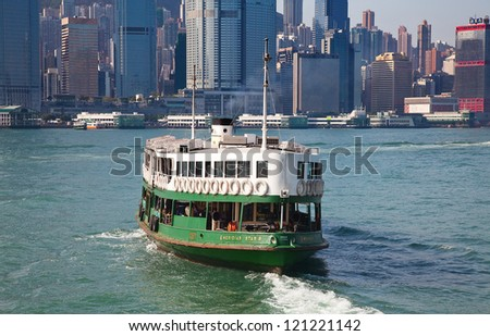 "HONG KONG - DECEMBER 3: Ferry ""Meridian star"" leaving Kowloon pier on December 3, 2010 in Hong Kong. Ferry is in operation in Victoria harbor for more than 120 years and is one of tourist attractions. - stock photo"