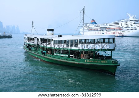 "HONG KONG - DECEMBER 14: Ferry ""Solar star"" leaving Kowloon pier on December 14, 2008 in Hong Kong, China. Ferry is in operation for over 120 years and is one main tourist attractions of the city. - stock photo"