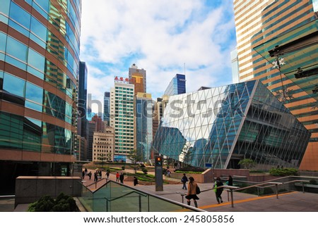 HONG KONG - DECEMBER 11, 2014: Hong Kong Special Administrative Region. Mirrored walls and red marble sidewalks. Super-modern architectural design of buildings in Hong Kong - stock photo