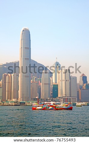 HONG KONG - DECEMBER 3: Star Ferry cruising harbor on December 3, 2010 in Hong Kong, China. Hong Kong ferry is in operation for more than 120 years and it is one main tourist attractions of the city. - stock photo