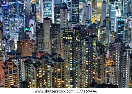 Hong Kong dense buildings at night - stock photo