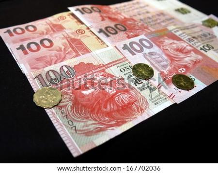 Hong Kong dollar bank notes and coins - stock photo