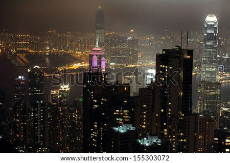HONG KONG - FEB 12 2009:Hong Kong cityscape skyline at night. Hong Kong city dense infrastructure became a center of modern architecture, earning Hong Kong the title of the world's most vertical city