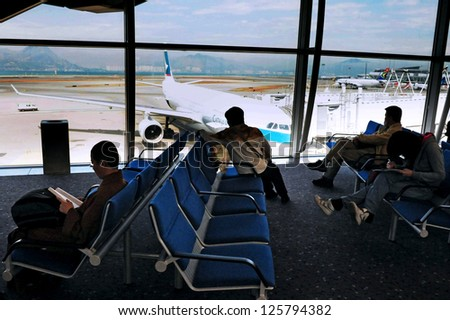HONG KONG - FEB 17:Passengers in Hong Kong International airport on February 17 2009.It's 10th busiest passenger airport in the world and the world's busiest airport by cargo traffic. - stock photo
