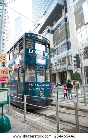 HONG KONG - FEBRUARY 07, 2015: Double-decker trams. Trams also a major tourist attraction and one of the most environmentally friendly ways of travelling in Hong Kong on February 07, 2015 in Hong Kong - stock photo
