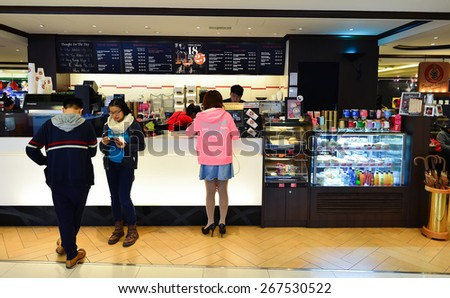 HONG KONG - FEBRUARY 04, 2015: Pacific Coffee cafe interior. Pacific Coffee Company is a Pacific Northwest U.S.- style coffee shop group originating from Hong Kong - stock photo