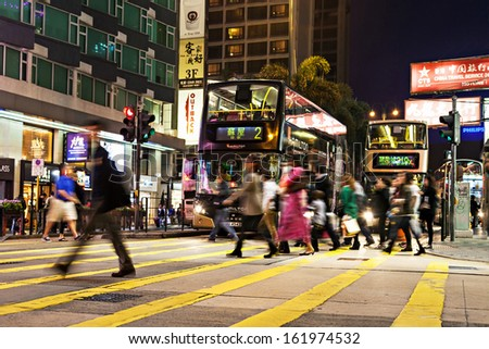 HONG KONG - FEBRUARY 21: Unidentified people crossing the street on February 21, 2013 in Hong Kong. With a 7 million people, Hong Kong is one of the most densely populated areas in the world  - stock photo