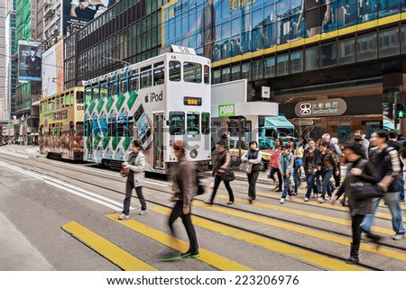 HONG KONG - FEBRUARY 21: Unidentified people crossing the street on February 21, 2013 in Hong Kong. With a 7 million people, Hong Kong is one of the most densely populated areas in the world. - stock photo