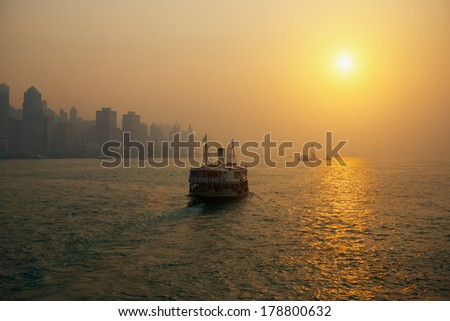Hong Kong ferry in the Bay at sunset - stock photo