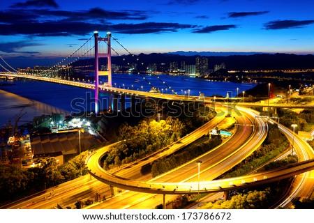 Hong Kong highway system and bridge at night - stock photo