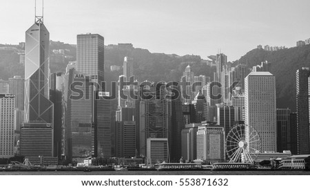 HONG KONG, HONG KONG - DECEMBER 10: Black and white tone sea front view with luxurious buildings in Hong Kong on  December 10, 2016