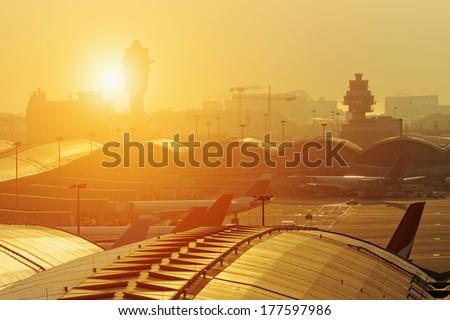 hong kong international airport traffic control tower at sunset - stock photo