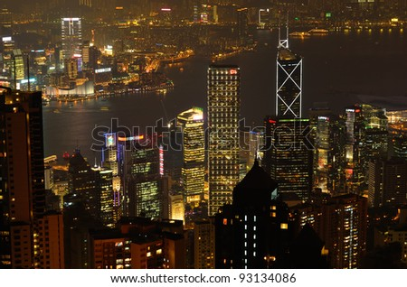 HONG KONG- JAN 5: Hong Kong central district skyline and Victoria Harbor in Hong Kong on Jan 5, 2012. With population of 7 million people, it is one of the most densely populated areas in the world