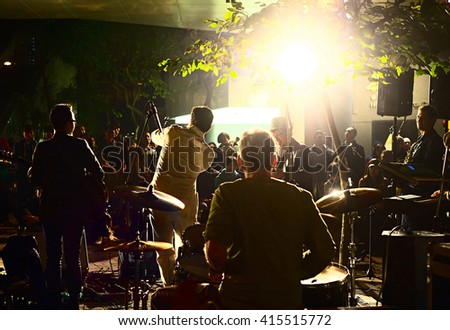 HONG KONG - JAN 19, 2013: Musical band playing in Hong Kong cultural institution in front of the audience in Hong Kong. Indie live-house is the new addition to the venue scene of the city. - stock photo