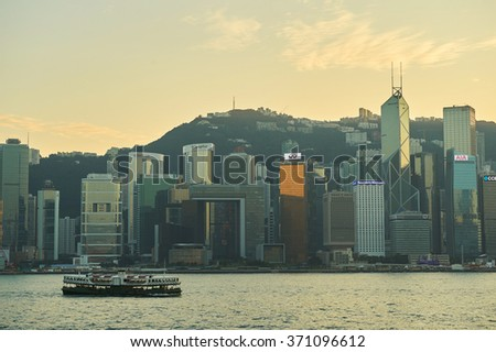 HONG KONG - JANUARY 25, 2016: dusk view of Hong Kong Island as seen from Tsim Sha Tsui. Hong Kong Island is an island in the southern part of the Hong Kong Special Administrative Region.