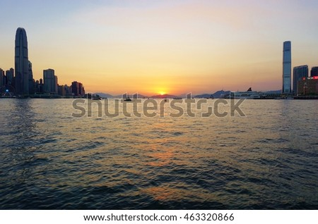 HONG KONG -28 JULY 2016- A view by night at sunset of the modern Hong Kong skyline as seen from the water in  Victoria Harbor.