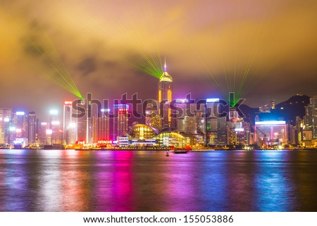HONG KONG - JULY 20: laser night show of Hong Kong Victoria Harbor July 20 2013. A Symphony of Lights is the spectacular light and sound show at Victoria Harbour  - stock photo