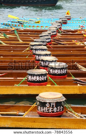 HONG KONG - JUN 6: The dragon boat stays along the rive after finished the dragon boat race on Tuen Ng Festival on June 6, 2011 in Tuen Mun, Hong Kong. - stock photo
