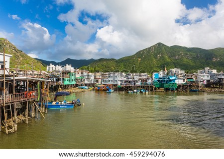 HONG KONG - JUN 28: Tourist are visiting by pleasure boat in Tai O on 28 June 2015. Tai O is a fishing town, located on the western side of Lantau Island in Hong Kong.