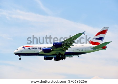 HONG KONG - JUNE 04, 2015: British Airways A380 landing at Hong Kong airport. British Airways is the flag carrier airline of the United Kingdom - stock photo