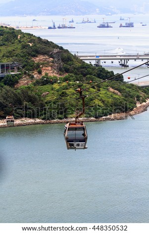 HONG KONG - JUNE 30 : cable car ride to Lantau Island in Hong Kong on June 30 2016. Lantau is the largest island in Hong Kong; located at the mouth of the Pearl River.