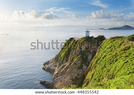 Hong Kong lighthouse during sunrise , Hok Tsui Cape D'Aguilar beautiful landscape - stock photo