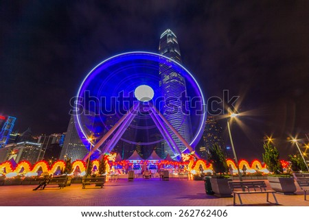HONG KONG - MAR 10, 2014: Hong Kong Observation Wheel in Central District of Hong Kong. It is 60 meters high and is easily reached with the MTR Central Station or the Star Ferry.  - stock photo