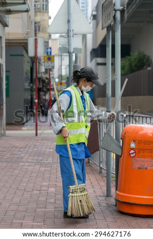 HONG KONG - MAR 30 : Street cleaning staff is cleaning the sidewalks on Mar 30,2015 in HONG KONG - stock photo