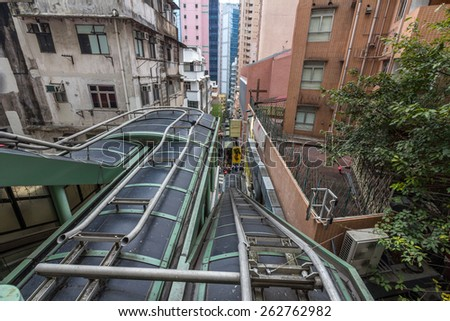 HONG KONG - MAR 10, 2014: The Central-Mid-Levels escalator and walkway system in Hong Kong is the longest outdoor covered escalator system in the world (800 m). It was constructed in 1993.  - stock photo