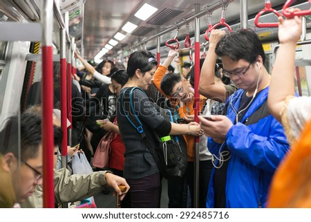 HONG KONG - MAR 29 : Tourists and locals are using the subway on March 29,2015 at MTR hong kong - stock photo